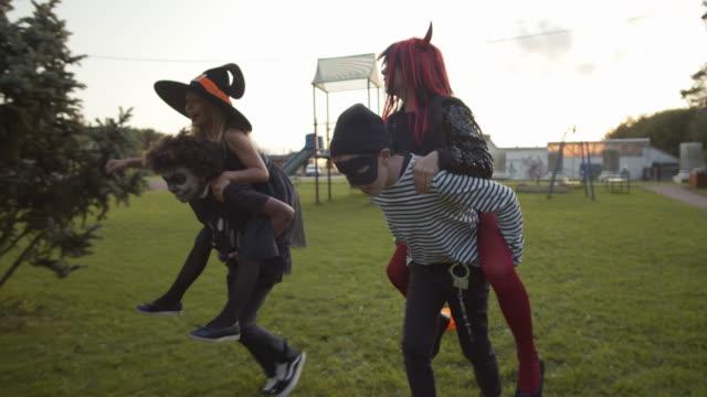 boys and girls having fun on halloween - four seasons filmów i materiałów b-roll