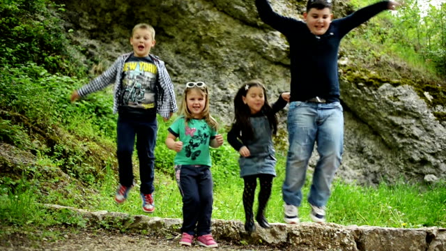 Boys and girls jumping. Slow motion. video