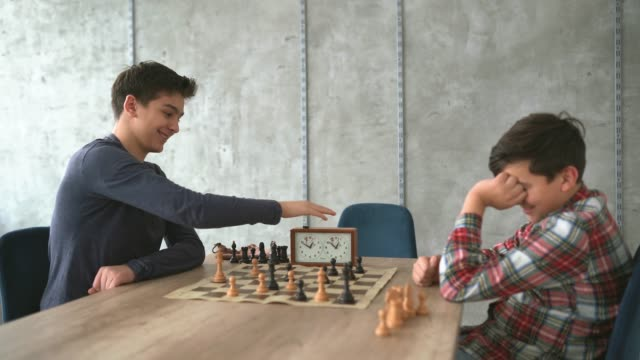 boys finishing the chess game - brother stock videos and b-roll footage
