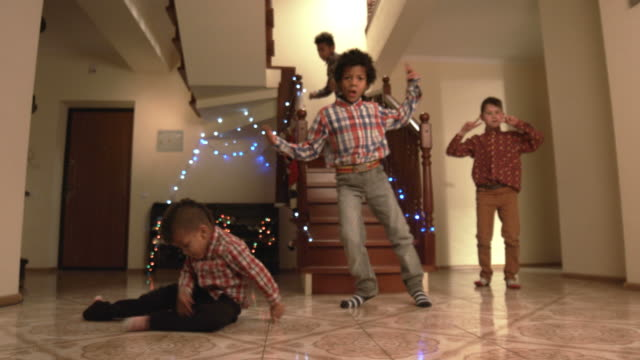 stockvideo's en b-roll-footage met boy's handstand tijdens kerst dans - christmas tree