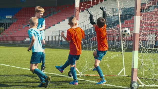 Boys losing soccer match Boys playing soccer on outdoor arena, trying to protect goal post but missing ball goal post stock videos & royalty-free footage