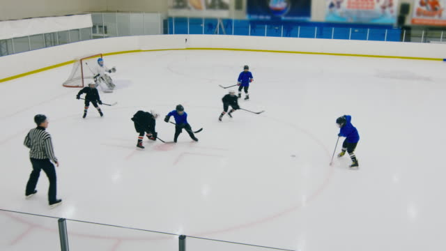 Boys making goal in hockey match Referee throwing the puck to start child hockey match and boys making goal fast goal post stock videos & royalty-free footage
