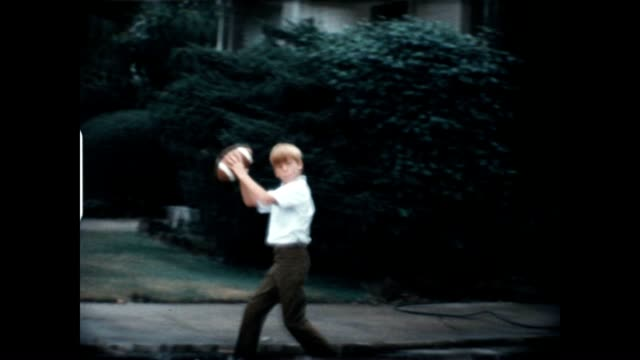 Boys Playing Football 1960's video
