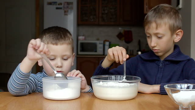 Boys prepare dough and rolling flour and milk video