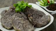 istock Braised Beef Shank slice ontop corainder thai herb served Galangal chili paste Thai northern Style 1280851105