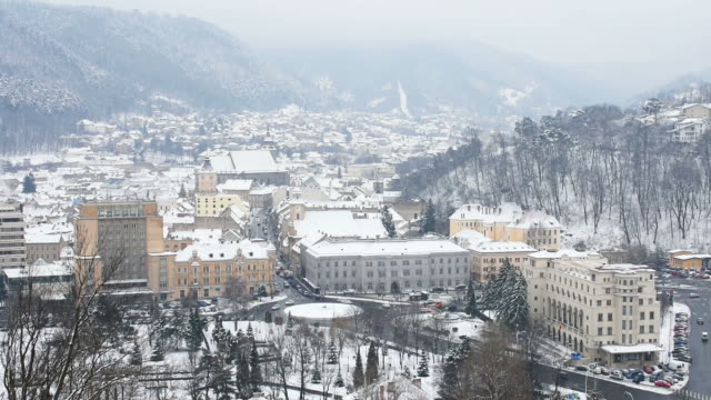 Brasov City , located in Transylvania region , Romania , winter scenery , the city seen from one of the surrounding hills  on a cold and misty day video
