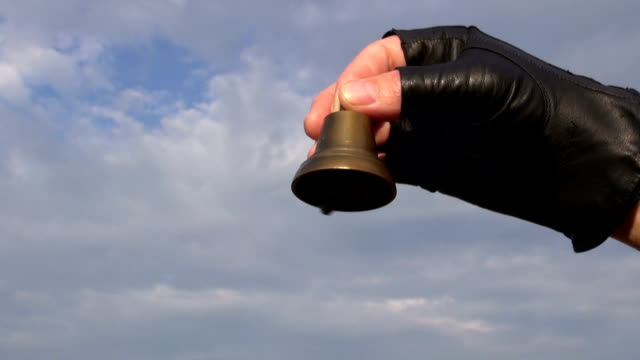 brass bell in hand and beautiful sound video