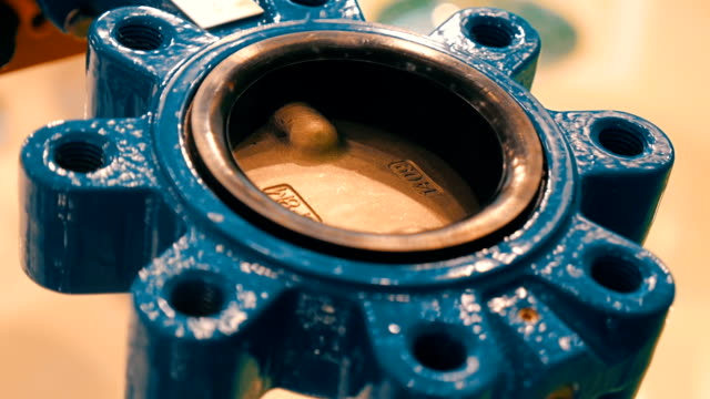 Brass damper of the valve as a spare part from an industrial crane for liquids video