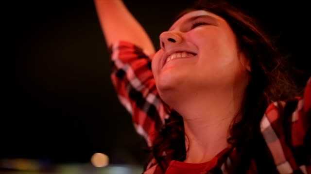 Brave teenage girl riding  on roller coaster,close up