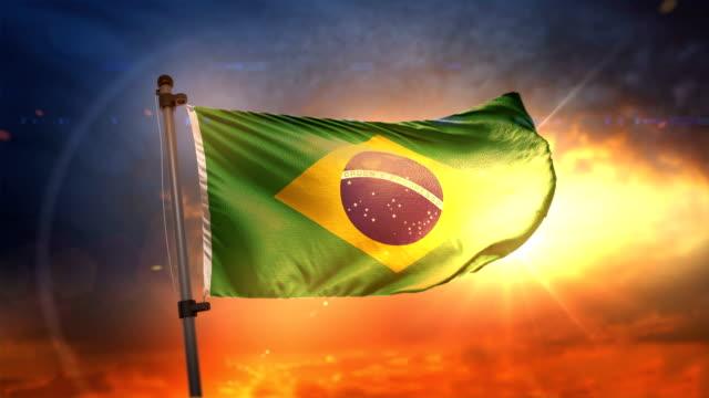 brasilien flagga bakgrundsbelyst vid vacker soluppgång loop slow motion 4k - brasilien flagga bildbanksvideor och videomaterial från bakom kulisserna