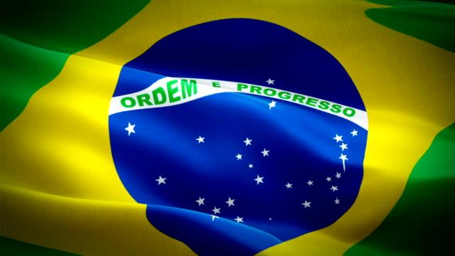 Video de Brasil bandeira acenando no vento. Fundo de bandeira brasileira realista. Closeup de Looping bandeira Brasil imagens Full HD 1920 X 1080 de 1080p. País europeu do Brasil da UE bandeiras vídeo de filmagens para cinema, notícias - vídeo