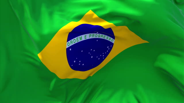 Brasil bandeira acenando em animação de movimento lento de vento. 4K realista bandeira de textura de tecido suave soprando em um dia ventoso fundo contínuas de Loop sem costura. - vídeo