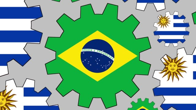 Brazilian and uruguayan flag gears spinning background zooming out video