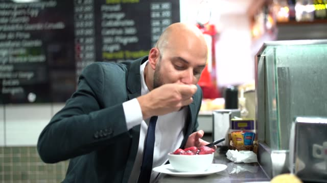 Brazilian Business man Eating Acai video