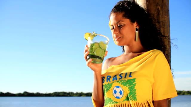 Brazilian girl drinking caipirinha video