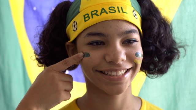 brasiliansk tjej - brasilien flagga bildbanksvideor och videomaterial från bakom kulisserna