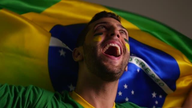Brazilian Guy Celebrating with Brazil Flag video