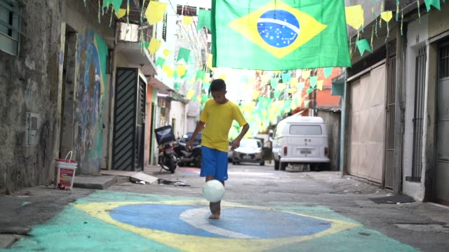 Brazilian Kid Playing Soccer in the Street Soccer is a world passion brazil stock videos & royalty-free footage