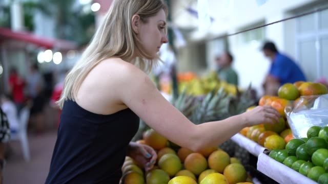 Brazilian Woman Buying Fruits on Street Market video
