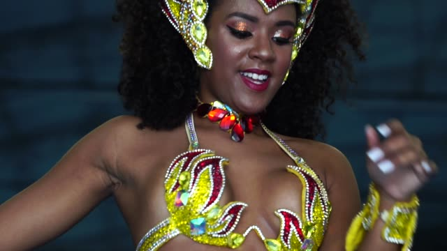 Brazilian woman dancing samba for the famous carnival parade The best of Brazilian carnival mardi gras stock videos & royalty-free footage