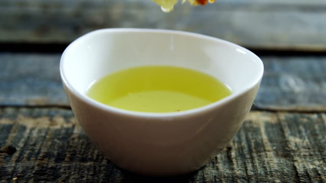 bread being dipped in olive oil - immergere video stock e b–roll