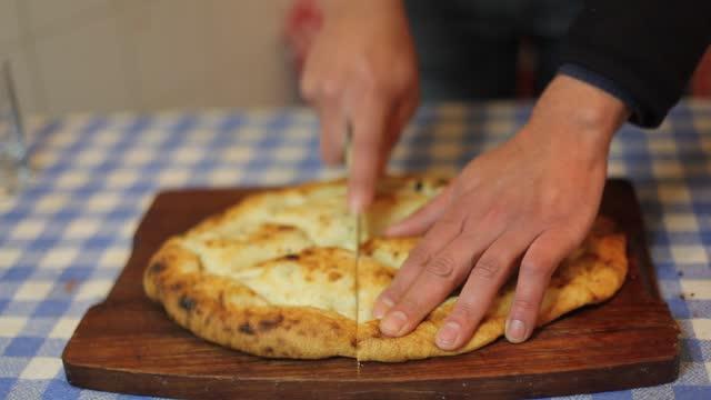 bread on cutting board in kitchen
