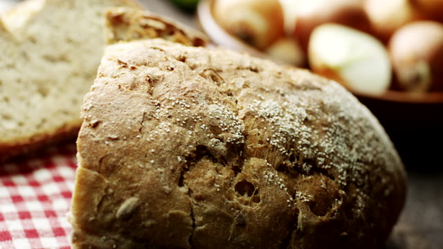 Bread on wooden table Bread on wooden table bread stock videos & royalty-free footage