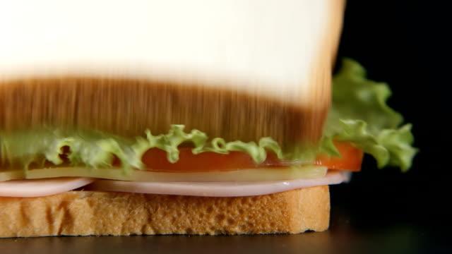 slow motion: bread slice falls on a sandwich - chef triste video stock e b–roll