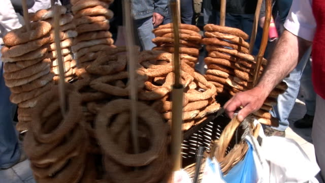 Bread Seller of typical bread in the streets of Athens, in a crowded place sesame stock videos & royalty-free footage