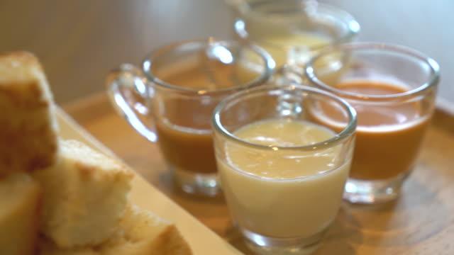 bröd med dip - dessert - vaniljsås bildbanksvideor och videomaterial från bakom kulisserna