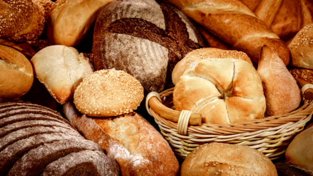 breads and baked goods - cucina francese video stock e b–roll