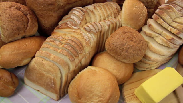 Breads With Sandwich Dolly across different breads and rolls revealing a tasty fresh made salad sandwich. bun bread stock videos & royalty-free footage
