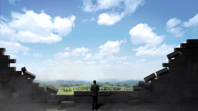 Break the wall. Businessman standing on way.