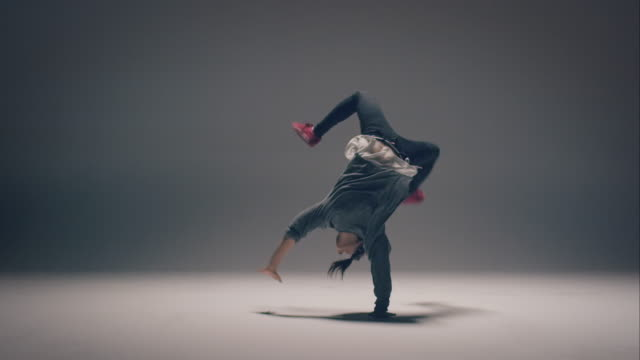 Breakdance woman Woman breakdancing in a clean enviroment. hip hop stock videos & royalty-free footage