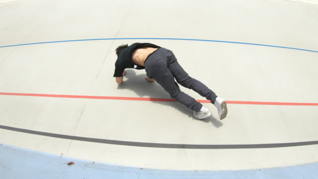 Breakdancer man make flips on a stadium video