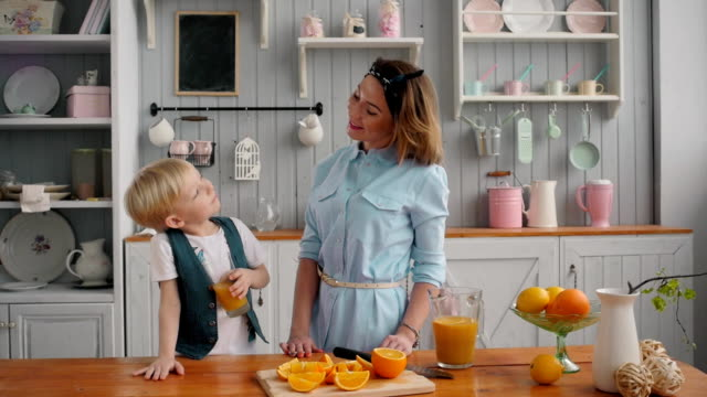 breakfast for an happy american family, mom and little child boy at kitchen video