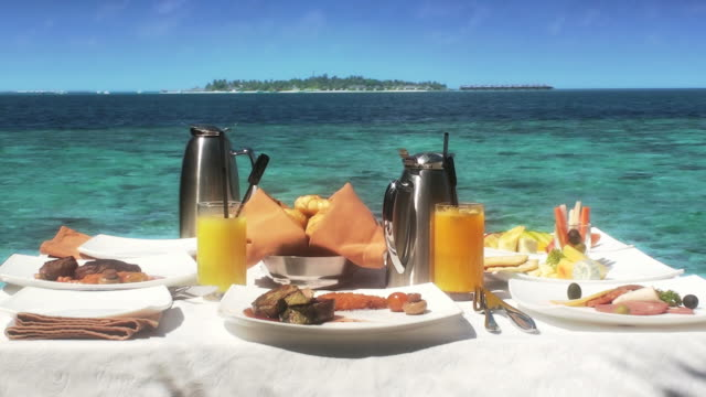 breakfast on the sea Tropical breakfast with the view of island resort indian ocean stock videos & royalty-free footage
