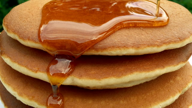 breakfast pancake stack with syrup poured on them - buffet video stock e b–roll