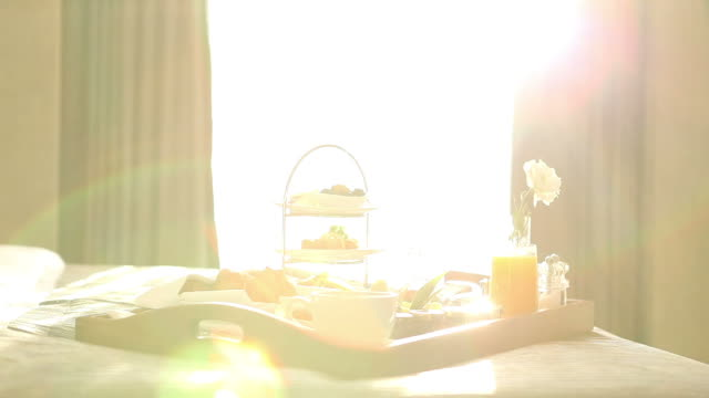 breakfast tray on bed - affluent lifestyle stock videos and b-roll footage