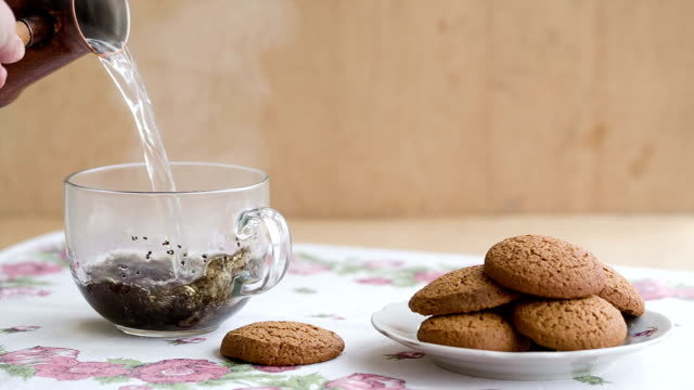 Breakfast with cup of tea and biscuits. video