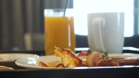 Breakfast with fried bacon and orange juice Breakfast with fried bacon and orange juice. Breakfast in bed in the hotel room. Food tray close-up breakfast stock videos & royalty-free footage