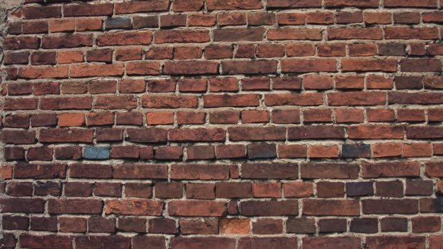 breaking red brick wall
