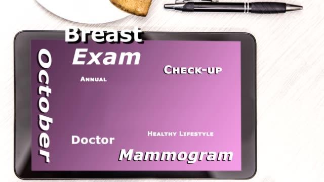 乳房癌認識詞雲數位平板電腦螢幕上。 - breast cancer awareness 個影片檔及 b 捲影像