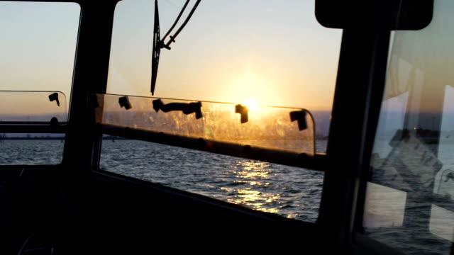 Breathtaking sunset, endless sea view from captain bridge on motorboat, slow-mo video