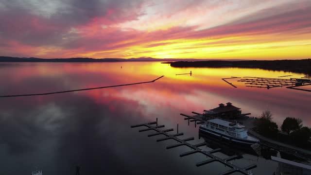 Breathtaking sunset over Lake Champlain in Burlington, VT (Aerial 4K Drone Video)