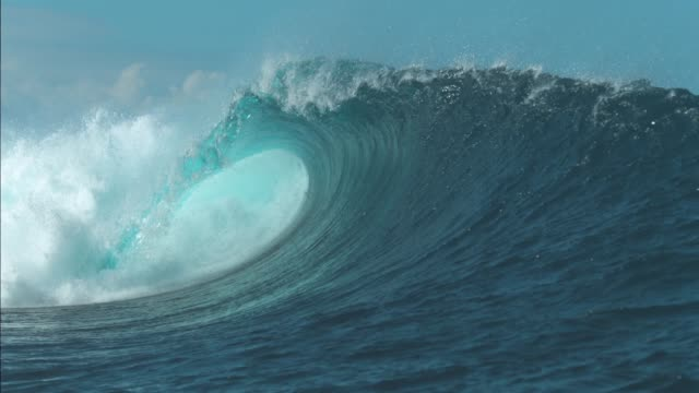 SLOW MOTION: Breathtaking turquoise barrel wave crashes on a perfect summer day. SLOW MOTION CLOSE UP: Breathtaking turquoise barrel wave crashes on a perfect summer day at the sea. Beautiful glistening tube wave crashes in the middle of the breathtaking ocean. Powerful water rush bent stock videos & royalty-free footage