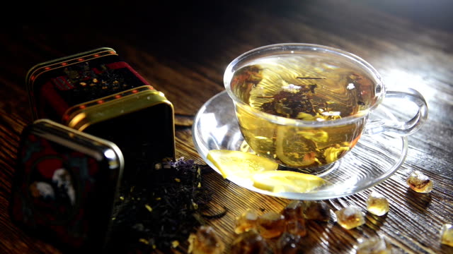 brew tea in a glass cup on a wooden background - cup stock videos & royalty-free footage