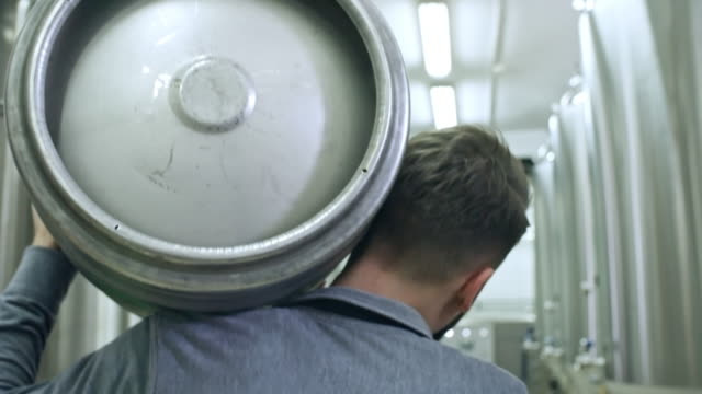 brewer going with beer keg - cask video stock e b–roll