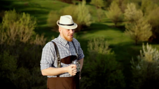 Brewer in checkered shirt tasting beer video