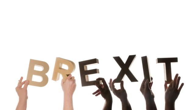 brexit i mänsklig hand resulterar i exit - brexit bildbanksvideor och videomaterial från bakom kulisserna